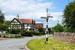 Village signpost and buildings, Weobley. Royalty Free Stock Photos