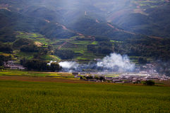 The village with smoke from kitchen Royalty Free Stock Images