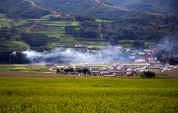 The village with smoke from kitchen Royalty Free Stock Image