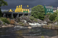 The village of Sneem - County Kerry - Ireland. The village of Sneem on the Iveragh Peninsula in County Kerry in the Republic of Ireland. The River Sneem flows Stock Photos