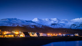 Village in the snow mountain at night time in the winter season Royalty Free Stock Photography
