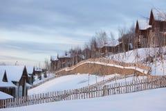 Village in snow season Stock Photos