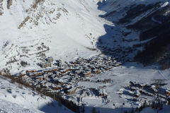 Village in snowy mountains Stock Images