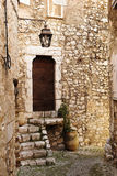 Village of St Paul. Buildings with windows and doors in the quaint little French hilltop village of Saint-Paul de Vence, Southern France, Alpes Maritimes, next Stock Photos