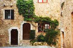 Village of St Paul. Buildings with windows and doors in the quaint little French hilltop village of Saint-Paul de Vence, Southern France, Alpes Maritimes, next Royalty Free Stock Image