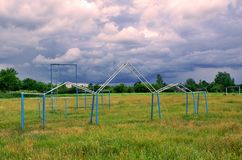 Village stadium. A rural athletic field ona green meadow Royalty Free Stock Images