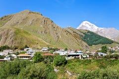 Village Stepantsminda and Mount Kazbek in Georgia Royalty Free Stock Image