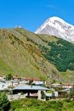 Village Stepantsminda and Mount Kazbek in Georgia Stock Photo