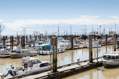 Village of Steveston Fisherman's Wharf in Richmond, BC. RICHMOND, CANADA - JULY 10: Colorful boats and trawlers dock at the seaside village of Steveston Royalty Free Stock Photo