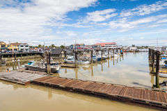 Village of Steveston Fisherman's Wharf in Richmond, BC. RICHMOND, CANADA - JULY 10: Colorful boats and trawlers dock at the seaside village of Steveston Stock Photos