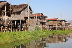 Village of stilt houses. A village of stilt houses in Inle lake, Myanmar. The houses are accessible only by boat Stock Photo