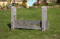 Village Stocks, England. Village stocks, used for punishement in the past, Ilmington, Warwickshire, England Stock Photo