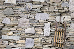 Village stone wall with sled background Royalty Free Stock Photos