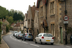 Village street. Old English village street with parked cars Royalty Free Stock Image