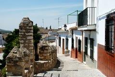 Village street, Cabra. Castle battlements and townhouses (Castillo de los Condes de Cabra), Cabra, Cordoba Province, Andalusia, Spain, Western Europe Stock Photo