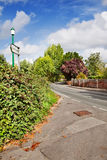 Village street intersection by Parish Church Stock Photos