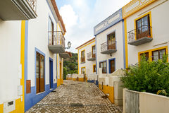 Village street with residential buildings in the town of Bordeira near Carrapateira, in the municipality of Aljezur in the Distric Royalty Free Stock Photos