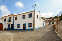 Village street with residential buildings in the town of Bordeira near Carrapateira, in the municipality of Aljezur Stock Photos