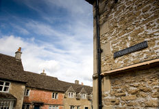 Village street and rooftops, UK Stock Images