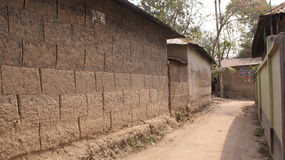 Village street showing mud houses and marl road Stock Photo