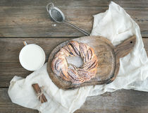 Village style breakfast set: sweet cinnamon ring bread and a cup Stock Photography