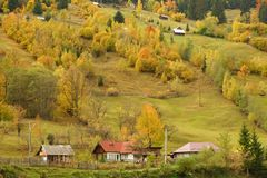 Yellow fields- Spectacle of nature in autumn. Village in Suceava Romania october 2017. Spectacle of nature in autumn. yellow fields, isolated houses red roof royalty free stock images