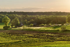 Village at sunset Farm Royalty Free Stock Images