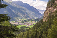 Village surrounded by Alps mountains. On a summer day royalty free stock images