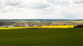 View of rural landscape with fields and suburban houses Stock Photo