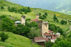 Village in the Swanetia region in Georgia. Watchtowers in villages being in Georgia in the Swaneti area in  the mountains of the Caucasus, UNESCO World Heritage Stock Images