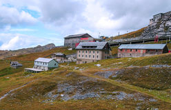 Village in the swiss Alps. With ski station, in a valley on a cloudy day Royalty Free Stock Photography