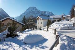 Village in Swiss Alps in winter. Beautiful village in Swiss Alps in winter Royalty Free Stock Images