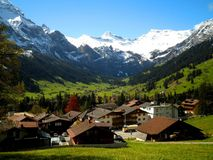 Village in Switzerland. A beautiful alpine setting with valley and mountains royalty free stock images