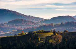 Village on top of a grassy knoll in autumn Stock Images