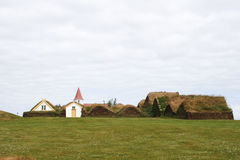 Village with traditional turfhouses and church Royalty Free Stock Photo
