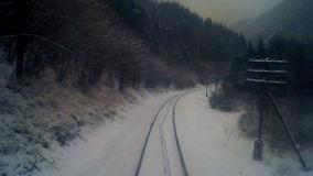 Village train move forest mountains. Fast shot of view of train window mountain forest covered by snow in winter cold season by day stock footage