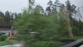 Village from the train window. The landscape village view from the train window stock footage