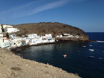 Village of Tufia on the coast of Gran Canaria. White houses on the seashore. Canary Islands, España stock image