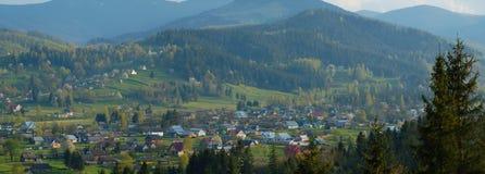 Village in Ukraine. Small village Kosmach surronded with mountains in ukrainian Carpathians Stock Image