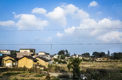 village under blue sky Stock Photos
