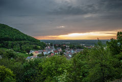Village under the hill at sunset Royalty Free Stock Images