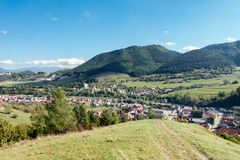 Village under hills and blue sky Stock Photography