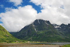 Village under the mountain in summer Lofoten Stock Image