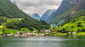 The Village of Undredal in Norway. The Picturesque village of Undredal seen from the Aurlandsfjord, Norway Royalty Free Stock Photos