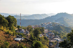 Village urbanization in the mountain and forest. Doi Mae Salong, Chiang Rai, Thailand Royalty Free Stock Photo