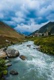 Village Ushguli landscape with massive rocky mountains Stock Photos