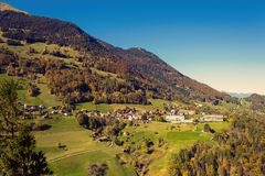 The village of Vättis and bridge against the background of Swiss Alps. St. Gallen, Switzerland. Top view. The village of Vättis against the background of Swiss Stock Image
