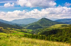 Village in the valley of Carpathian mountains. Abranka village in the valley of Carpathian mountains, Ukraine. lovely countryside scenery in early autumn with royalty free stock photos