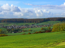 Village at the valley with crops growing around Royalty Free Stock Images