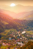 Village in a valley of mountain river Stock Photography